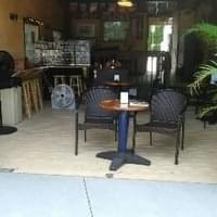 Outdoor covered patio sells beer and wine by the…