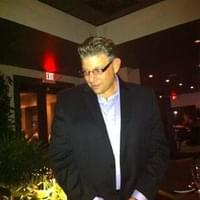 Owner Keith Williamson visiting patrons at Tables.…