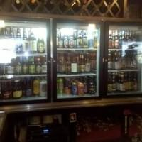 bottled beer refrigerator at the bar.
