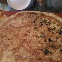 Huge pizza! Half ham and pineapple and the other…