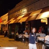 Outside at night with outdoor seating