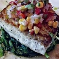 Halibut over spinach with corn salsa
