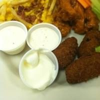 Sampler with loaded fries, hot wings and homemade…