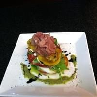 Heirloom tomato caprese topped with fresh shaved…