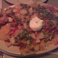 Nachos, topped with fresh, minced jalapeno