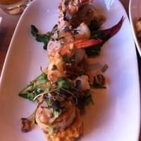 Scallops and shrimp on risotto cakes