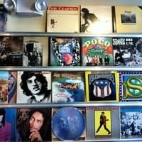 Interesting wall decorated with LP record albums.…