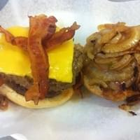 Double bacon cheese burger with grilled onions..